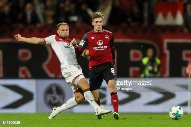 Bernd Nehrig of St Pauli und Lucas Hufnagel of Nuernberg battle for the ball during the Second Bundesliga match between 1 FC Nuernberg and FC St...