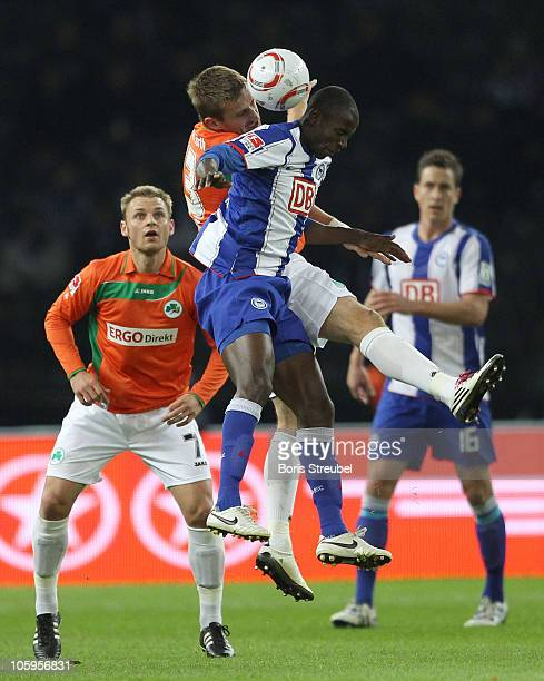 Bernd Nehring of Fuerth watches his team mate Milorad Pekovic and Adrian Ramos of Berlin jumping for a header during the Second Bundesliga match...