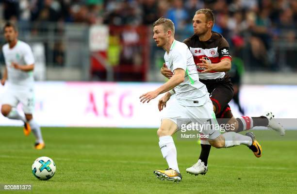 Bernd Nehring of St Pauli and Florian Kainz of Bremen battle for the ball during the preseason friendly match between FC St Pauli and Werder Bremen...