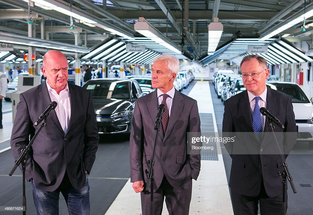Bernd Osterloh, labor leader of Volkswagen AG, left, speaks during a news conference with Matthias Mueller, chief executive officer of Volkswagen AG, center, and Stephan Weil, prime minister of the German state of Lower Saxony, after meeting with employees on the VW Golf automobile assembly line, at the automaker's headquarters in Wolfsburg, Germany, on Wednesday, Oct. 21, 2015. Faced with billions of euros in costs for its emissions cheating scandal, Volkswagen may have to consider an overhaul of a 12-brand empire built in the last two decades that makes everything from cheap cars to motorbikes to heavy trucks. Photographer: Krisztian Bocsi/Bloomberg via Getty Images
