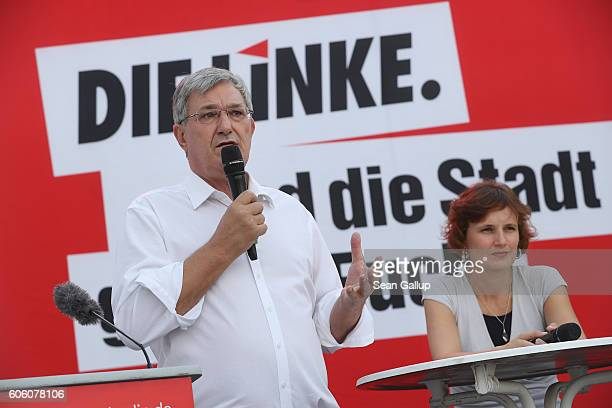 Bernd Riexinger and Katja Kipping leading members of the leftwing Die Linke political party speak to supporters at an election campaign rally ahead...
