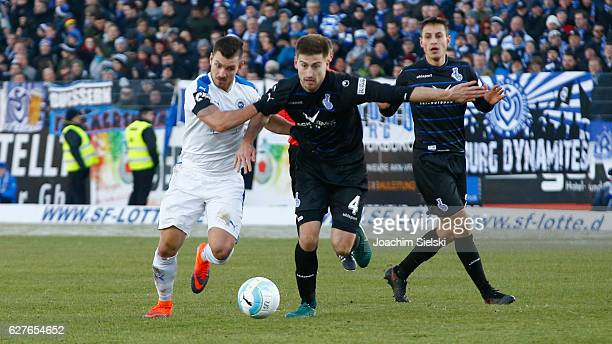 Bernd Rosinger of Lotte challenges Dustin Bomheuer of Duisburg during the third league match between Sportfreunde Lotte and MSV Duisburg at Frimo...