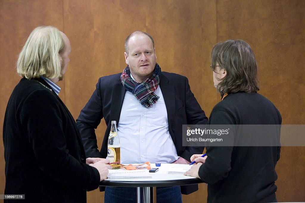 Bernd Schloemer, federal chairman of the Pirate party, talking with journalists at the Pirate Party National Convention at RuhrCongress on November 24, 2012 in Bochum, Germany. German Pirates have a lot to achieve as the party is flagging in the polls and facing national elections in less than a year.