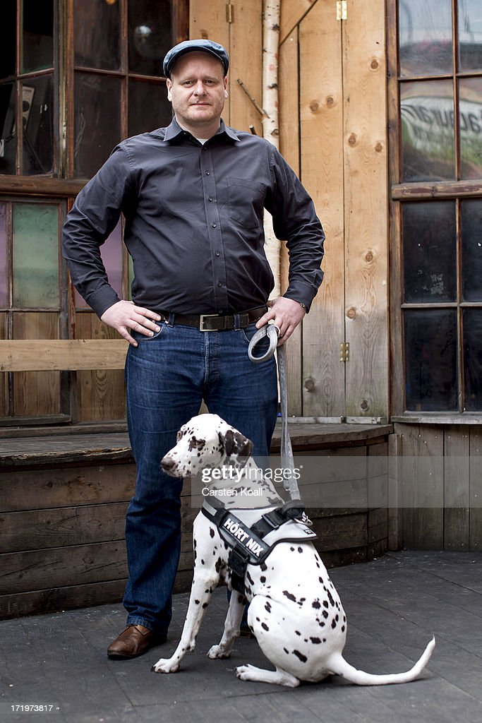 Bernd Schloemer, head of the German Pirates Party (Die Piraten), posing with his dog during a photoshooting at the offical launch of the party's election campaign on July 30, 2013 in Berlin, Germany. The Pirates Party rode a wave of voter discontent and managed to land seats in several German state parliaments in the last two years, though inner squabbles and a lack of clear direction have led to a decline in the party's popular support. Germany faces federal elections in September.