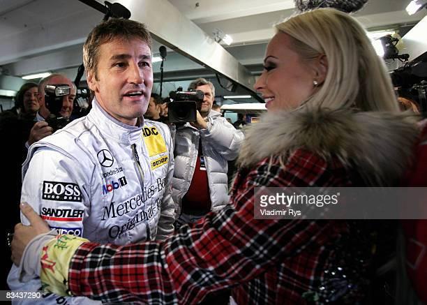 Bernd Schneider of AMG Mercedes CKlasse gets a hug from Cora Schumacher wife of DTM and former Formula One driver Ralf Schumacher during the photo...