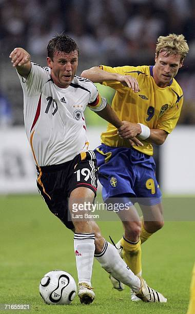 Bernd Schneider of Germany in action with Christian Wilhelmsson of Sweden during the friendly match between Germany and Sweden at the Arena Auf...