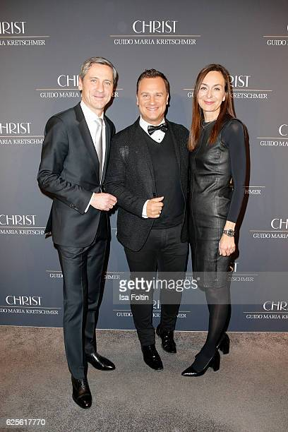 DR Bernd Schroeder Guido Maria Kretschmer and Ursula Vierkoetter attend the 'Gluecksmuenz' collection launch by Guido Maria Kretschmer at CHRIST...