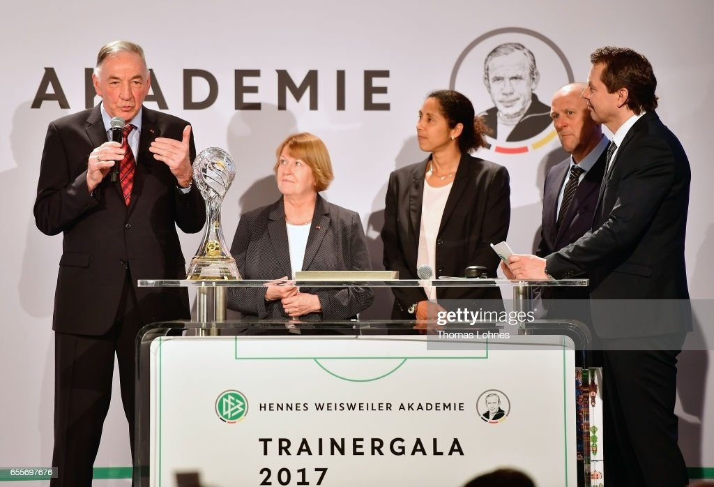 Bernd Schroeder (2-R), the former head coach of the women's team of 1.FFC Turbine Potsdam get the coach lifetime award 2016 from Steffi Jones, head coach of Germany women's national team,ÊHannelore Ratzenburger, vice president of German football association (DFB), Markus Hoegner and Ralf Koettker, media director of DFB (L-R) on March 20, 2017 in Neu Isenburg, Germany.