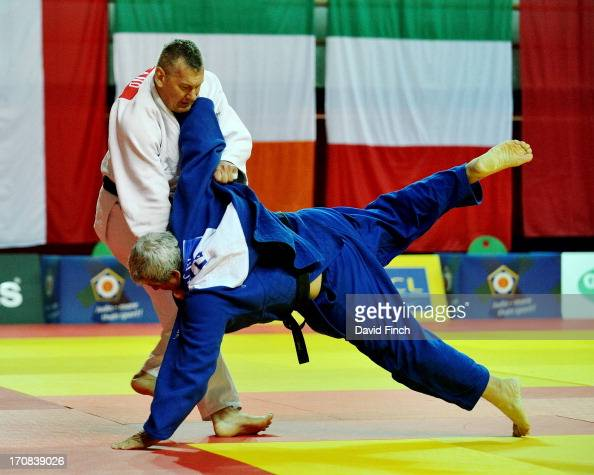 Bernd Weigand of Germany defeated Giuseppe Macri of Italy with this foot sweep to win the M6 o100kgs bronze medal during day three at the 2013...