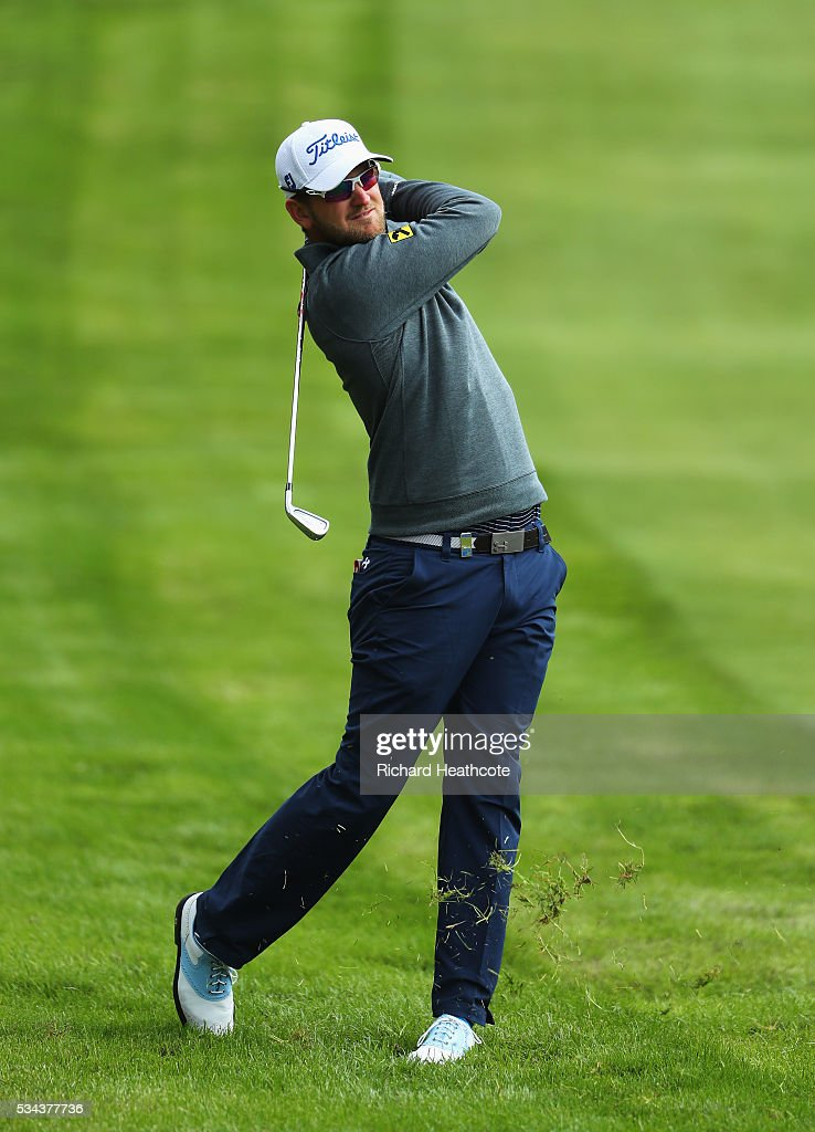 Bernd Weisberger of Austria hits his 2nd shot on the 4th hole during day one of the BMW PGA Championship at Wentworth on May 26, 2016 in Virginia Water, England.