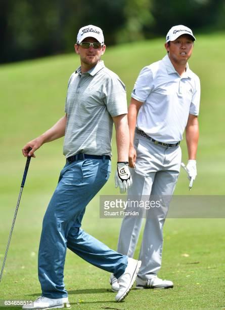 Bernd Wiesberger of Austria and David Lipsky of USA watch a shot during Day Three of the Maybank Championship Malaysia at Saujana Golf Club on...