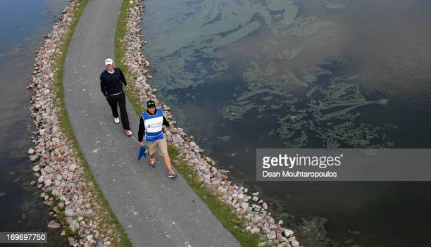 Bernd Wiesberger of Austria and his caddie walk off the 17th green during Day Two of the Nordea Scandinavian Masters at Bro Hof Slott Golf Club on...