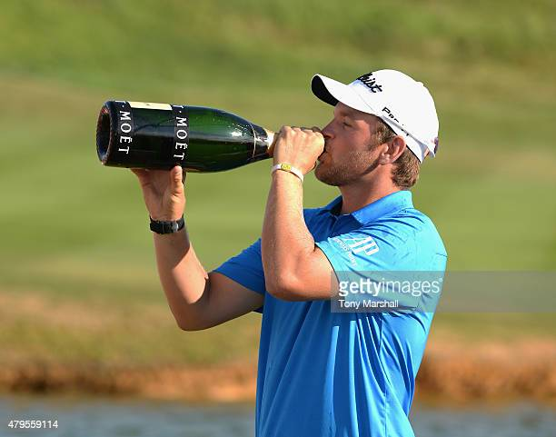 Bernd Wiesberger of Austria celebrates his win with some champagne during the Alstom Open de France Day Four at Le Golf National on July 5 2015 in...