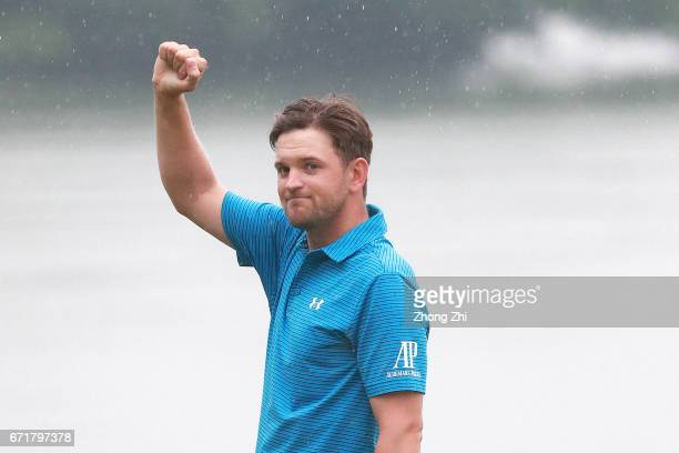 Bernd Wiesberger of Austria celebrates his winning putt during the play off against Tommy Fleetwood of England during the final round of the Shenzhen...