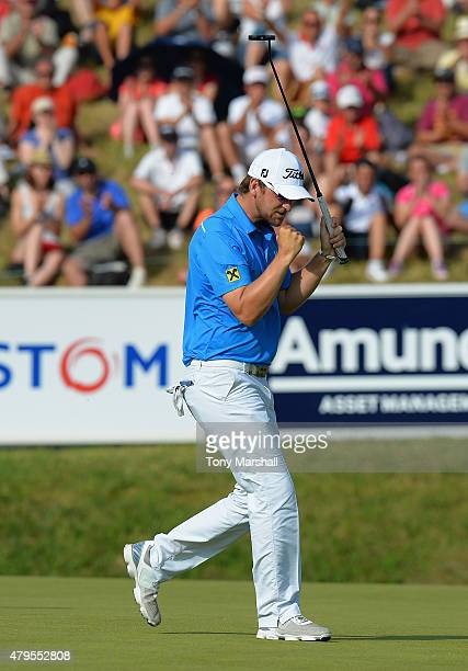 Bernd Wiesberger of Austria celebrates sinking a birdie putt on the 18th green to win on 13 under par the Alstom Open de France Day Four at Le Golf...