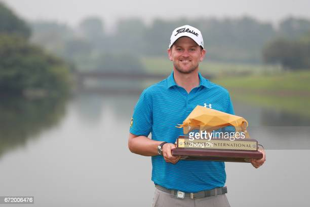 Bernd Wiesberger of Austria celebrates with his trophy after winning the Shenzhen International at Genzon Golf Club on April 23 2017 in Shenzhen China