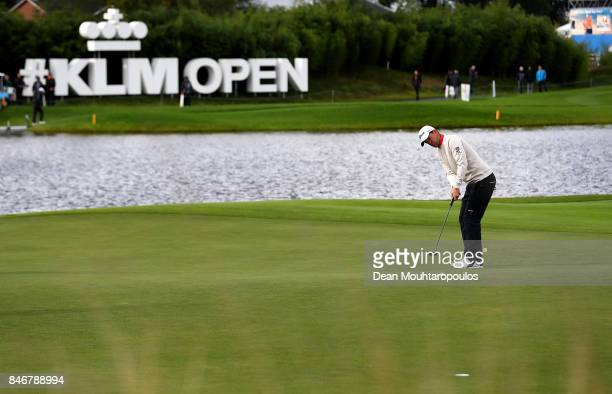 Bernd Wiesberger of Austria hits a putt on the 18th green during day one of the European Tour KLM Open held at The Dutch on September 14 2017 in...