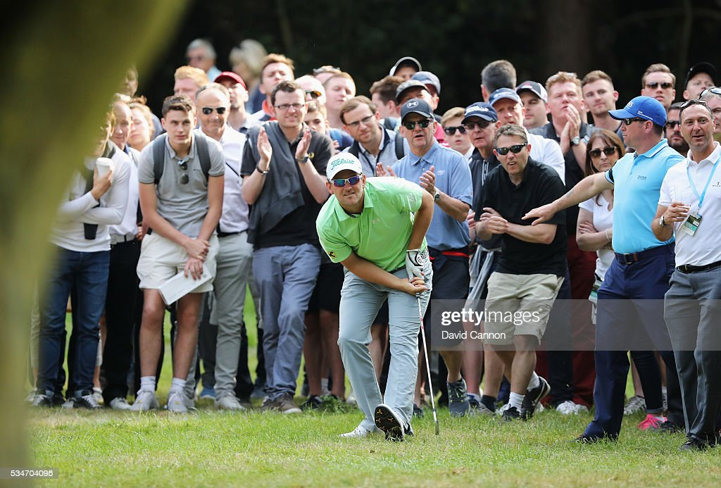 Bernd Weisberger of Austria hits his 2nd shot on the 17th hole during day two of the BMW PGA Championship at Wentworth on May 27, 2016 in Virginia Water, England.