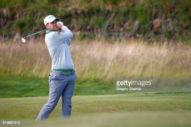 Bernd Wiesberger of Austria hits his second shot on the 13th hole during day one of the AAM Scottish Open at Dundonald Links Golf Course on July 13...