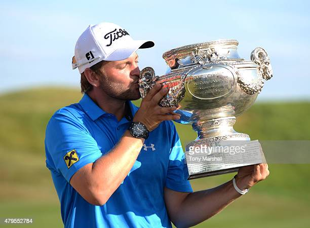 Bernd Wiesberger of Austria kisses the trophy after winning the Alstom Open de France Day Four at Le Golf National on July 5 2015 in Paris France