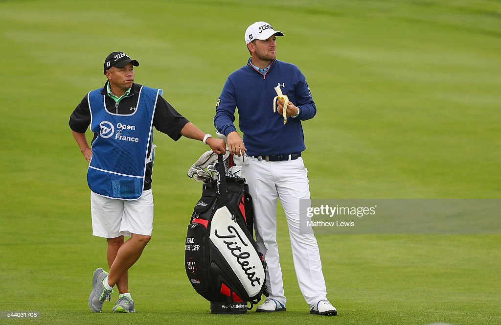 <a gi-track='captionPersonalityLinkClicked' href=/galleries/search?phrase=Bernd+Wiesberger&family=editorial&specificpeople=4025132 ng-click='$event.stopPropagation()'>Bernd Wiesberger</a> of Austria looks on with his caddie Shane Koerier during day two of the 100th Open de France at Le Golf National on July 1, 2016 in Paris, France.