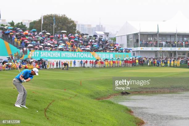 Bernd Wiesberger of Austria plays a shot during the play off against Tommy Fleetwood of England during the final round of the Shenzhen International...