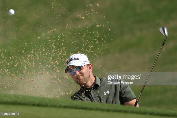 Bernd Wiesberger of Austria plays a shot out of the bunker on the 18th hole of his match during round one of the World Golf ChampionshipsDell...