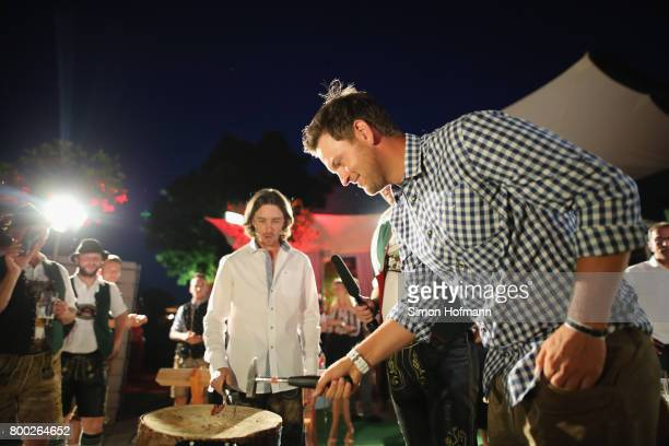 Bernd Wiesberger of Austria plays a typical Bavarian game during the BMW International Players Night at P1 Club on June 23 2017 in Munich Germany