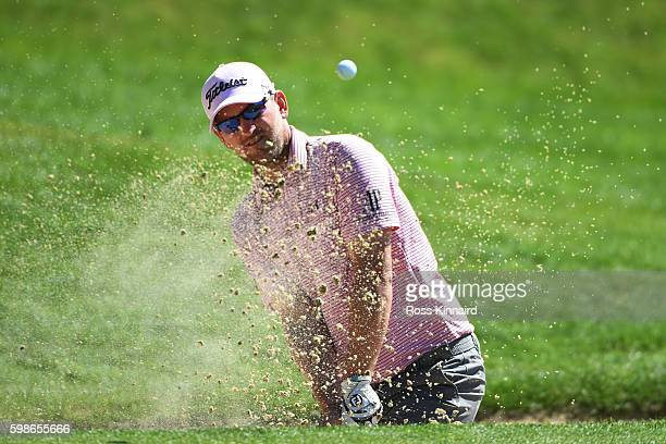 Bernd Wiesberger of Austria plays his second shot from a bunker on the eighth hole during the second round of the Omega European Masters at...