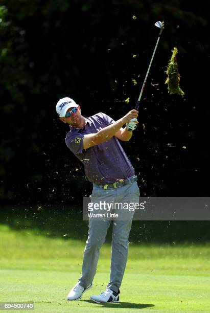 Bernd Wiesberger of Austria plays his second shot into the third green during the third roud of the Lyoness Open at Diamond Country Club on June 10...