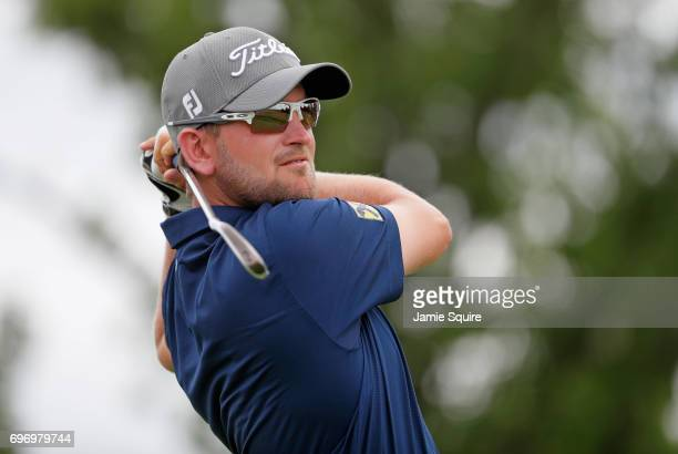 Bernd Wiesberger of Austria plays his shot from the fourth tee during the third round of the 2017 US Open at Erin Hills on June 17 2017 in Hartford...