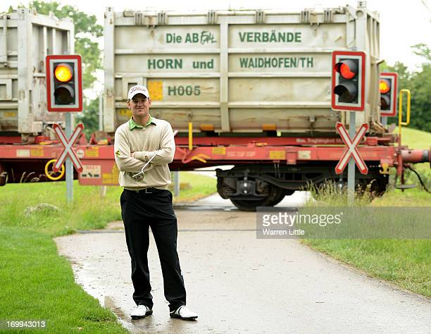 Bernd Wiesberger of Austria poses as a train passes during the pro am of the Lyoness Open at Diamond Country Club on June 5 2013 in Atzenbrugg Austria