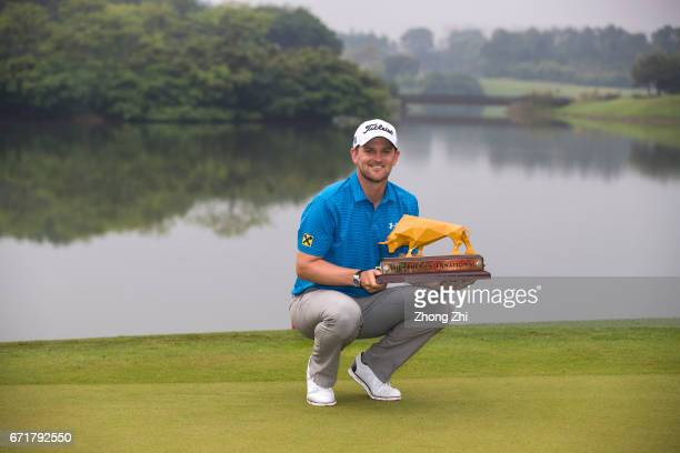 Bernd Wiesberger of Austria poses with the trophy after winning the Shenzhen International at Genzon Golf Club on April 22 2017 in Shenzhen China