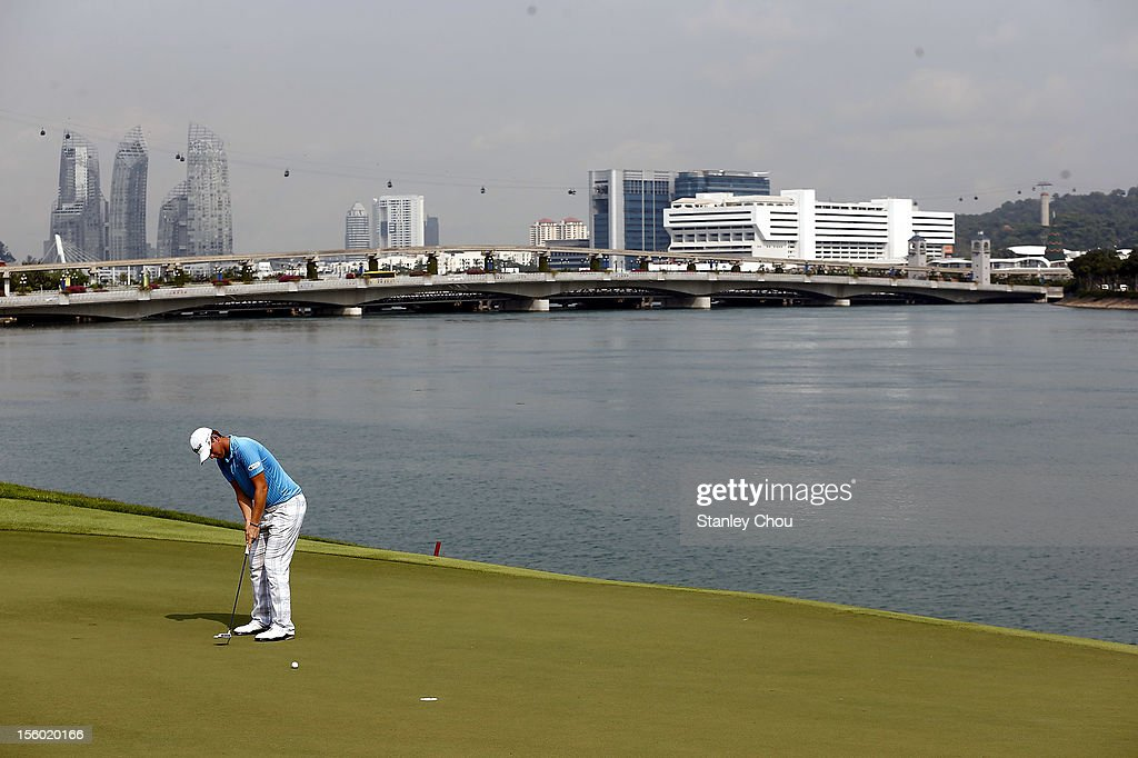 <a gi-track='captionPersonalityLinkClicked' href=/galleries/search?phrase=Bernd+Wiesberger&family=editorial&specificpeople=4025132 ng-click='$event.stopPropagation()'>Bernd Wiesberger</a> of Austria putts on the 15th hole during the fourth round of the Barclays Singapore Open at the Sentosa Golf Club on November 11, 2012 in Singapore.