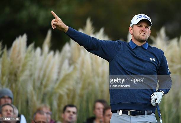 Bernd Wiesberger of Austria reacts after hitting his tee shot on the 17th hole during the fourth round of the British Masters at The Grove on October...