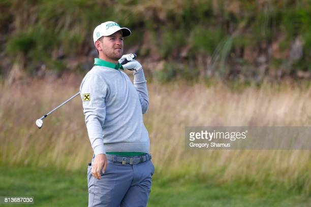Bernd Wiesberger of Austria reacts to his second shot on the 13th hole during day one of the AAM Scottish Open at Dundonald Links Golf Course on July...