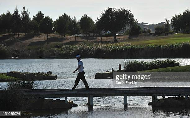 Bernd Wiesberger of Austria walks over a bridge during the third round of the Portugal Masters at the Victoria golf course at Villamoura on October...