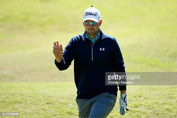 Bernd Wiesberger of Austria waves to the gallery after a birdie on the seventh hole during the second round of the World Golf ChampionshipsDell Match...