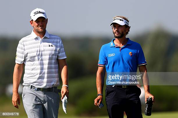 Bernd Wiesberger of South Africa walks with Joost Luiten of the Netherlands during the first round on day one of the KLM Open at The Dutch on...