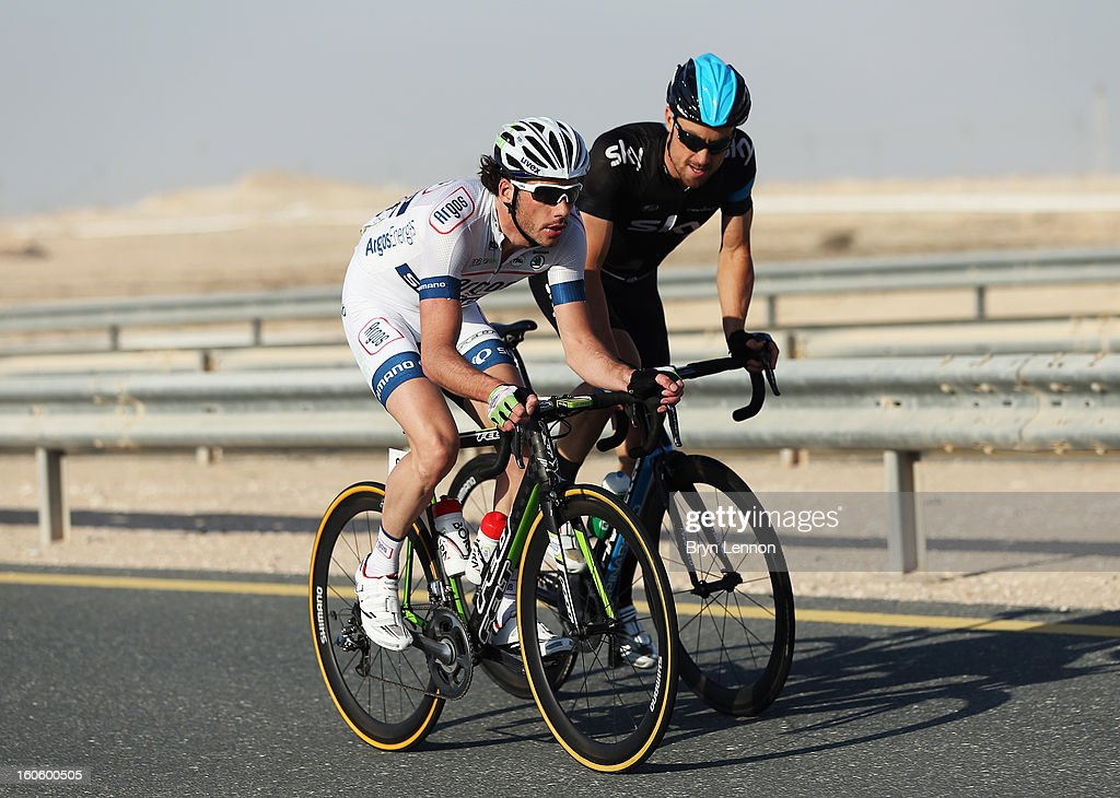 Bernhard Eisel of Austria and SKY Procycling rides with Roy Curvers of the Netherlands and Team Argos-Shimano at the front of the race on stage one of the 2013 Tour of Qatar from Katara Cultural Village to Dukhan Beach on February 3, 2013 in Dukhan Beach, Qatar.