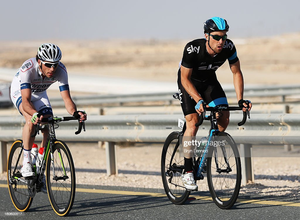 Bernhard Eisel of Austria and SKY Procycling rides with Roy Curvers of the Netherlands and Team Argos-Shimano on stage one of the 2013 Tour of Qatar from Katara Cultural Village to Dukhan Beach on February 3, 2013 in Dukhan Beach, Qatar.