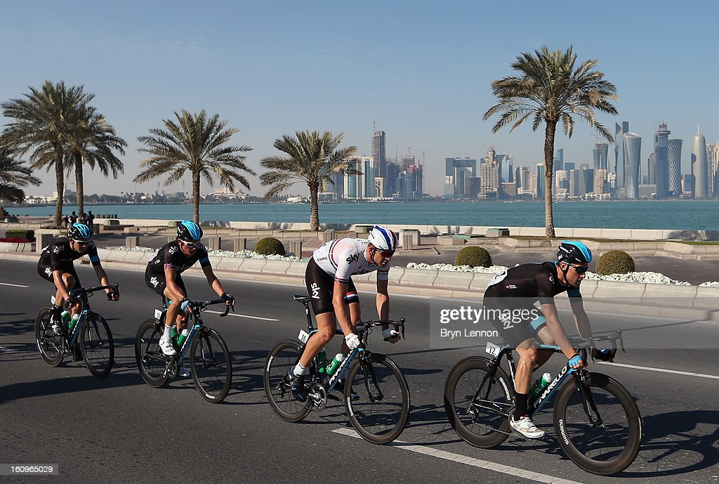 Bernhard Eisel of Austria leads SKY Procycling team mates Ian Stannard, Gerinat Thomas and Luke Rowe during stage six of the 2013 Tour of Qatar from Sealine Beach Resort to Doha Corniche on February 8, 2013 in Doha, Qatar.