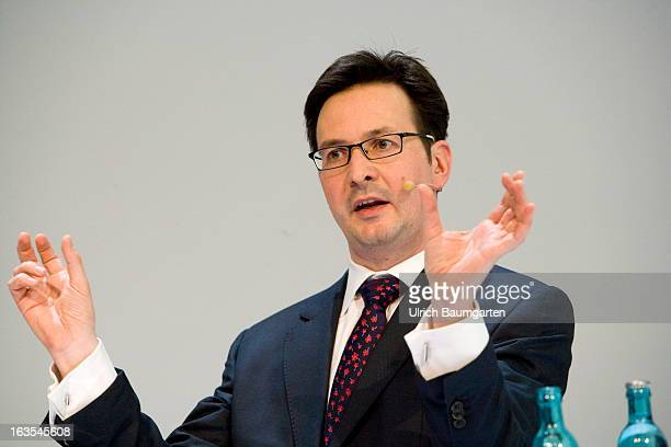 Bernhard Guenther financial chairman of the RWE AG gestures during an annual press conference to present the 2012 financial results on March 5 2013...