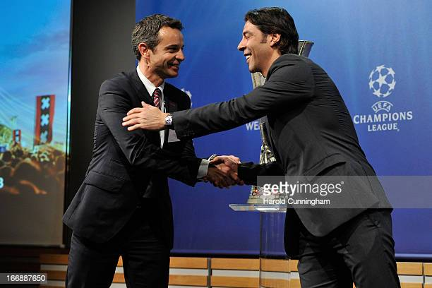 Bernhard Heusler of FC Basel and Rui Costa of SL Benfica shake hands during the UEFA Europa League semifinal and final draw at the UEFA headquarters...