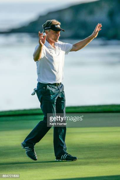 Bernhard Langer acknowledges the gallery introduction on the 18th green during the final round of the Champions Tour Pure Insurance Championship on...