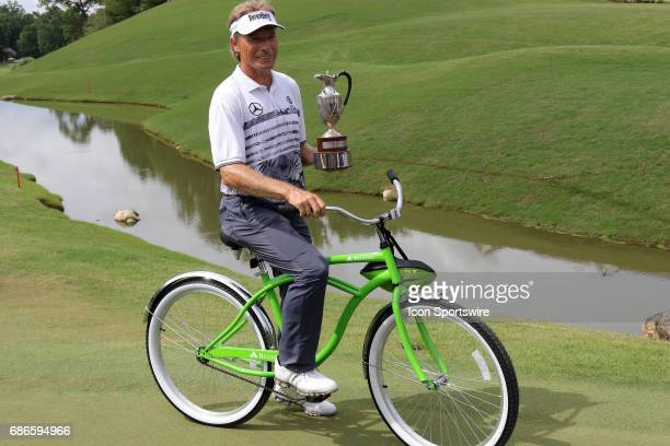 Bernhard Langer holds up the championship trophy and sits on the Regions Bank bycycle after winning the 2017 Regions Tradition during the final round...