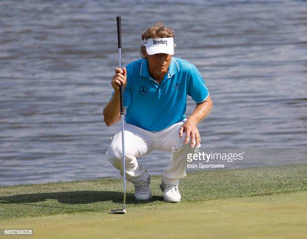 Bernhard Langer lines up his putt on the 18th green during the final round of the Mitsubishi Electric Classic tournament at the TPC Sugarloaf Golf...