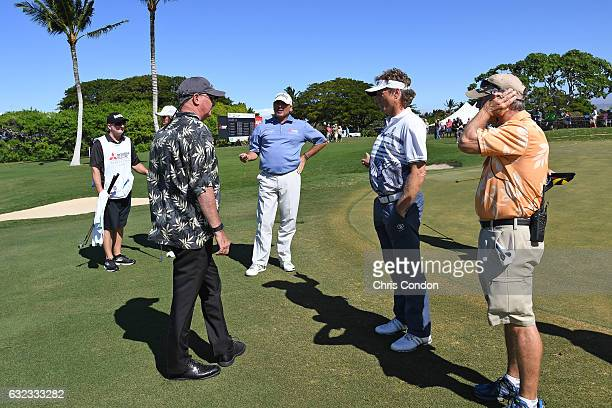 KA'UPULEHUKONA HI JANUARY 21 Bernhard Langer of Germany and Fred Couples discuss the weather delay with a rules official during the final round of...