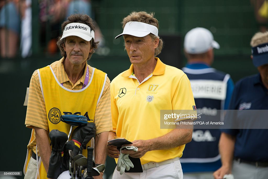 <a gi-track='captionPersonalityLinkClicked' href=/galleries/search?phrase=Bernhard+Langer&family=editorial&specificpeople=167071 ng-click='$event.stopPropagation()'>Bernhard Langer</a> of Germany and his caddie on the first hole during the third round for the 77th Senior PGA Championship presented by KitchenAid held at Harbor Shores Golf Club on May 28, 2016 in Benton Harbor, Michigan.