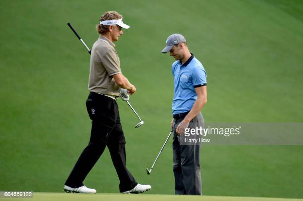 Bernhard Langer of Germany and Martin Kaymer of Germany stand on the tenth green during a practice round prior to the start of the 2017 Masters...